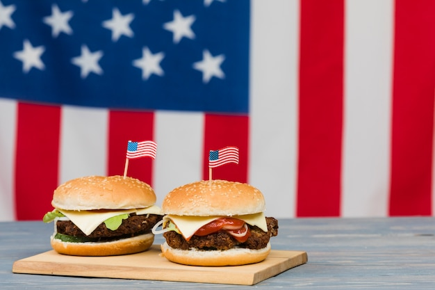 Cheeseburgers on wooden board Free Photo