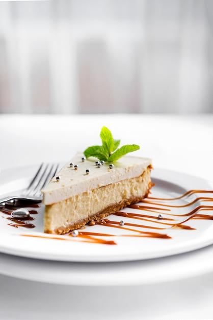 Cheesecake on white plate Premium Photo