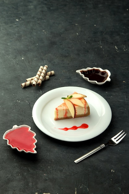 Cheesecake with apple slices on the table Free Photo