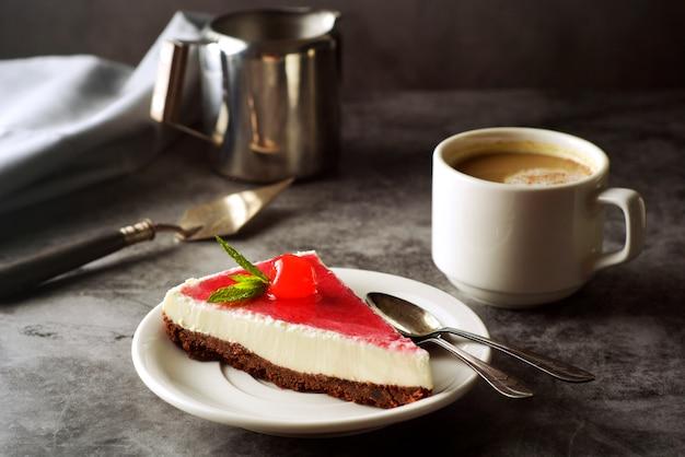 Cheesecake with cherry on dark Premium Photo