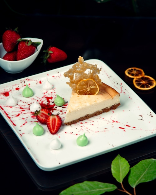 Cheesecake with sliced strawberries on plate Free Photo