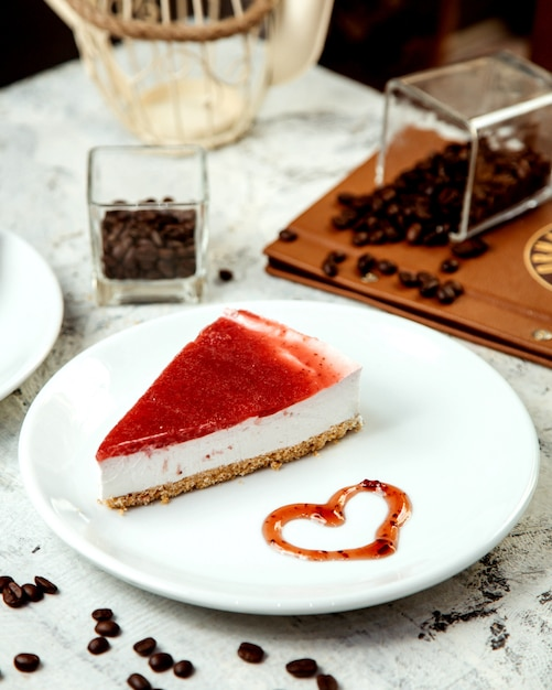 Cheesecake with strawberry jam on top Free Photo