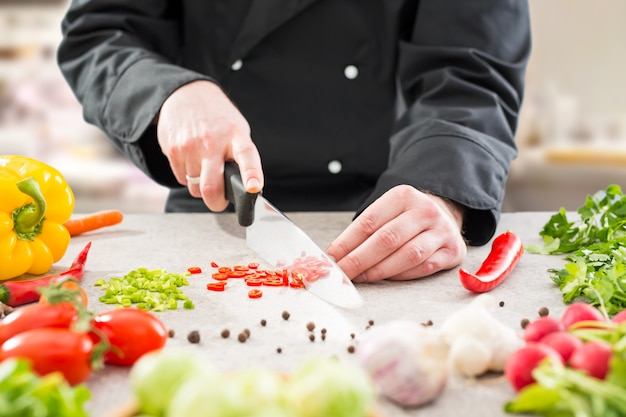 Chef cooking food kitchen restaurant cutting prepare cook Premium Photo