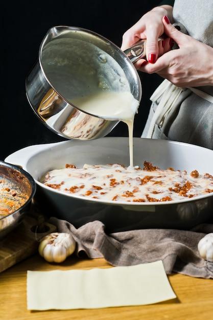 The chef cooking homemade italian lasagna Premium Photo