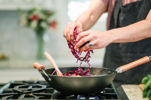 Chef cooking up a vegan pasta dish Free Photo