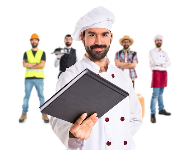 Chef giving a book Free Photo