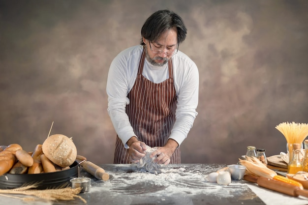Chef hipster stylish kneads dough for bread on wooden board Premium Photo