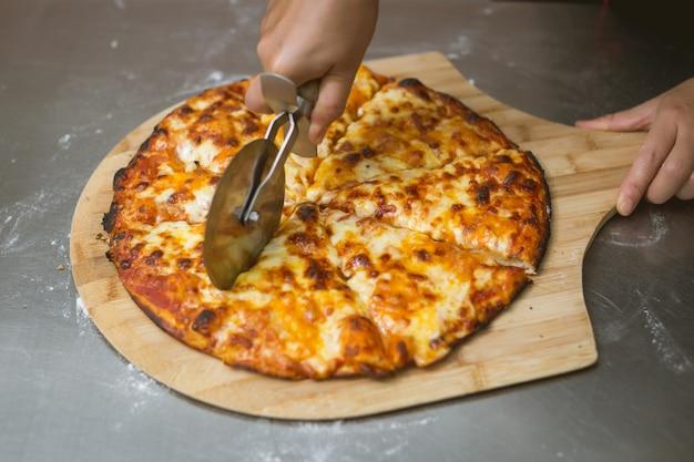 Chef making pizza at kitchen Free Photo
