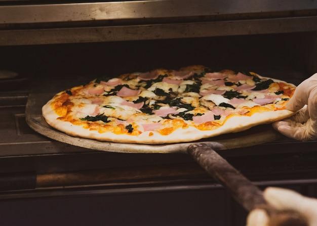 Chef prepares delicious pizzas on the kitchen Premium Photo