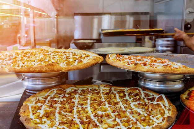 Chef in preparing delicious pizza at kitchen. italian style pizza on the counter before baking. Premium Photo