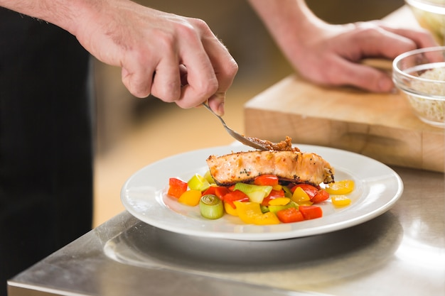 Chef preparing a dish of healthy food Free Photo