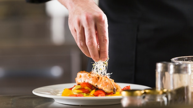 Chef preparing a dish of healthy food Premium Photo