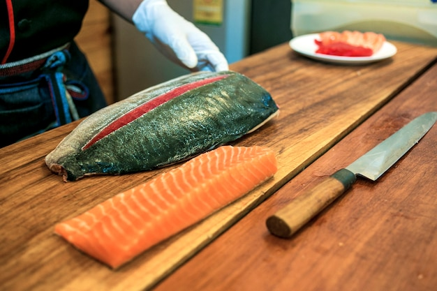 Chef preparing fresh tuna and salmon fillet Premium Photo