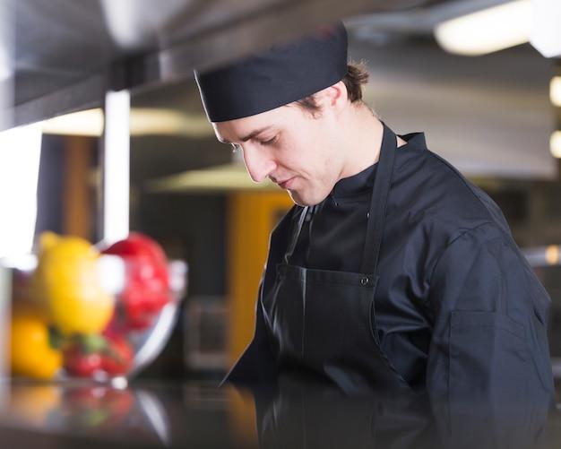 Chef preparing a recipe Free Photo