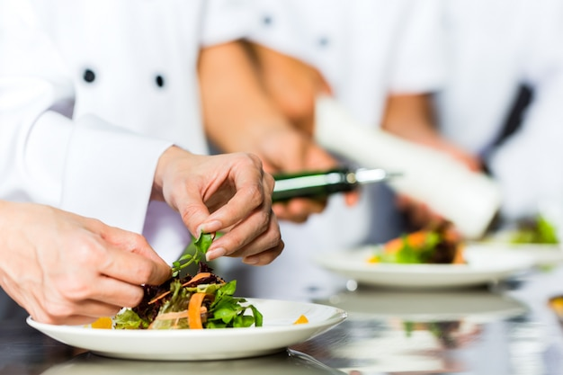 Chef in restaurant kitchen cooking Premium Photo