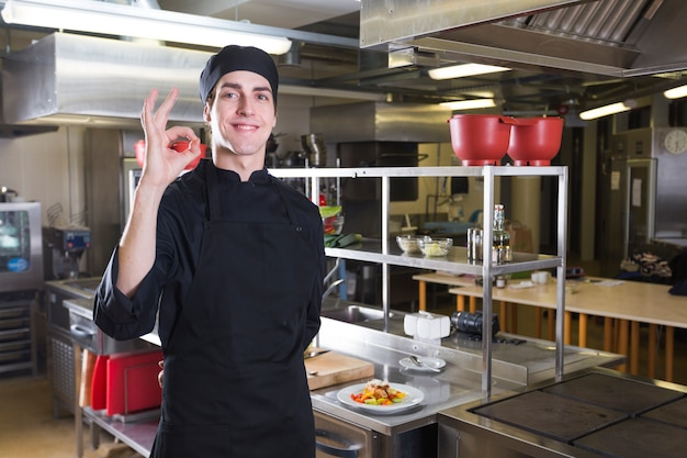 Chef with uniform in a kitchen Free Photo