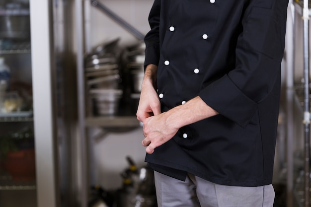 Chef with uniform and utensil kitchen Free Photo