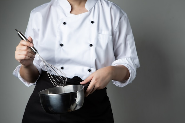 Chef with whipping tool pastry food mixing ingredient Premium Photo