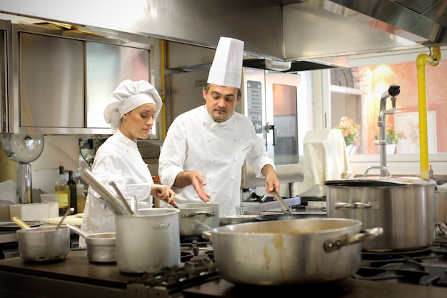 Chefs working in the kitchen Premium Photo