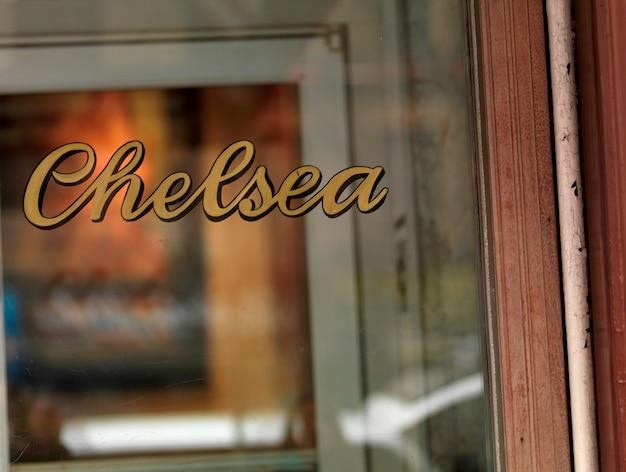 Chelsea sign on a window in manhattan, new york city, u.s.a. Premium Photo