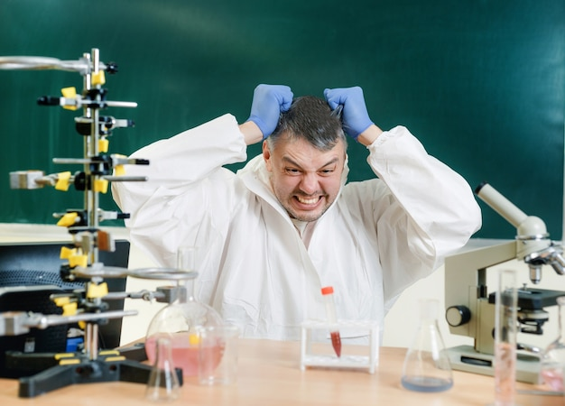 A chemist in the laboratory is dissatisfied with the result of his experiment. real emotions. close-up Premium Photo