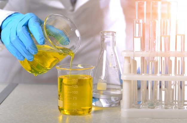 In the chemistry lab, women scientists are doing experiments Premium Photo