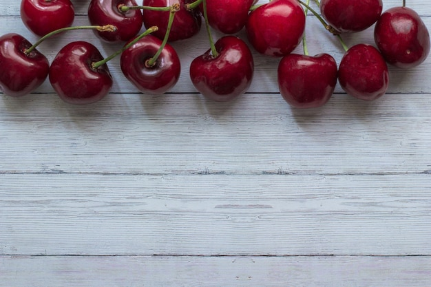 Cherry berries on a wooden background top view Premium Photo