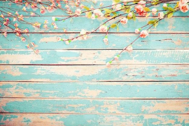 Cherry blossom flowers on vintage wooden background, border design Premium Photo