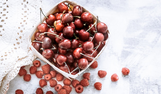 Cherry in a small basket Free Photo