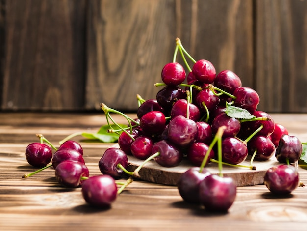 Cherry on wooden board Free Photo