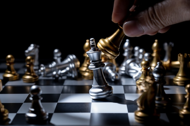 Chess board game for business concept in light and shadow. Premium Photo