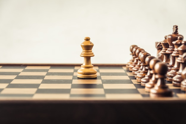 Chess on board  white backgroung. confrontation concept Premium Photo
