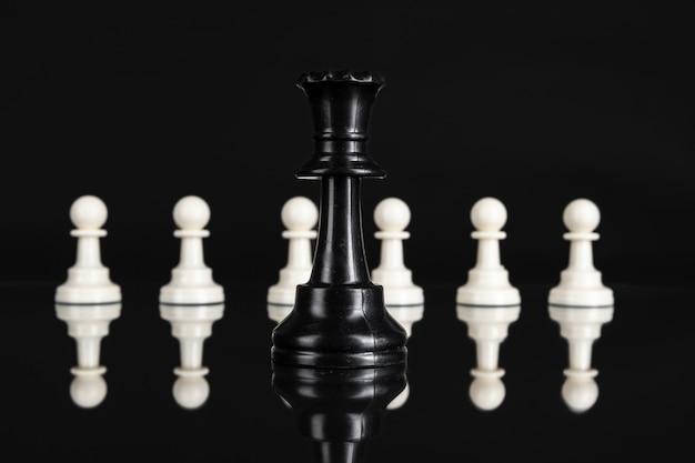 Chess figures on dark Premium Photo