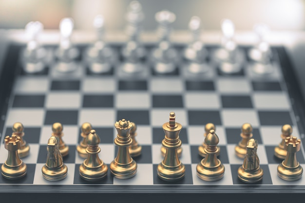 Chess game, set the board waiting to play in both gold and silver pieces Premium Photo