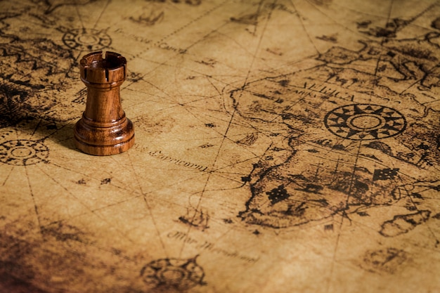 Chess on old map Premium Photo