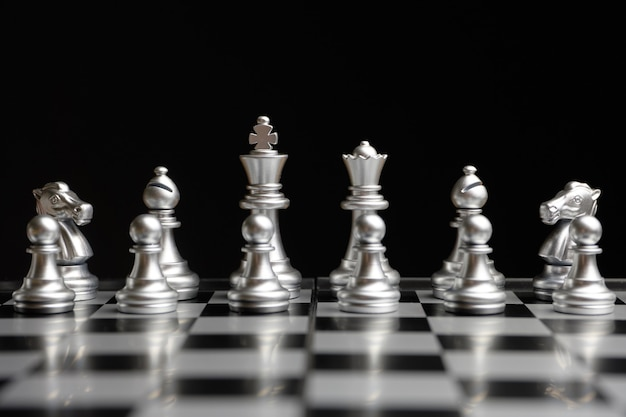 Chess pieces are lined up and ready to play Premium Photo