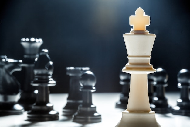 Chess pieces on a black surface Premium Photo