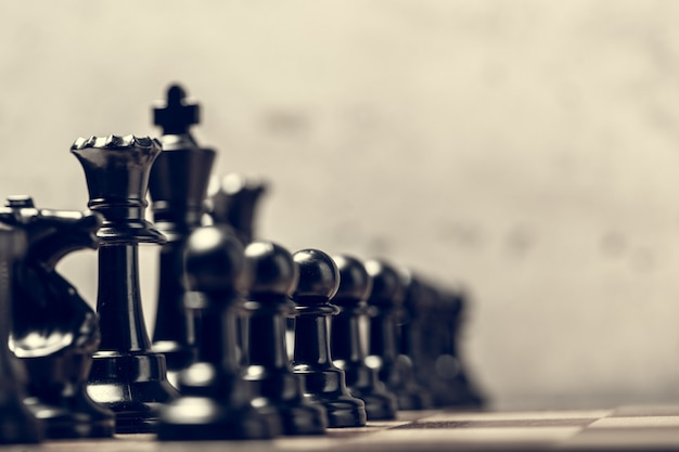 Chess pieces on the board in blur selective focus Premium Photo