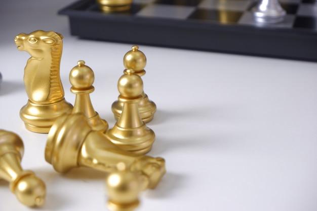 Chess on white table Premium Photo