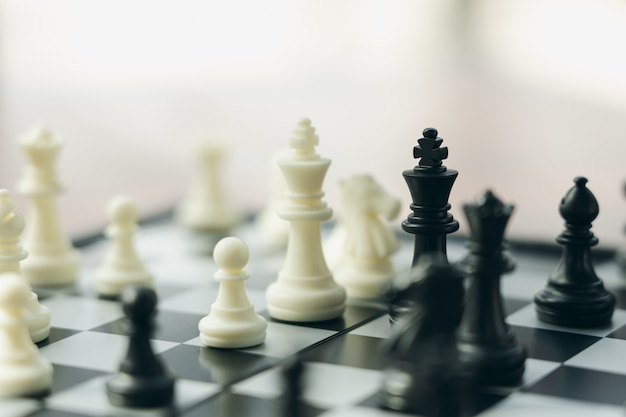 Chessboard with a chess piece on the back negotiating in business. Premium Photo
