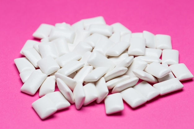 Chewing gum close up on a pink Premium Photo
