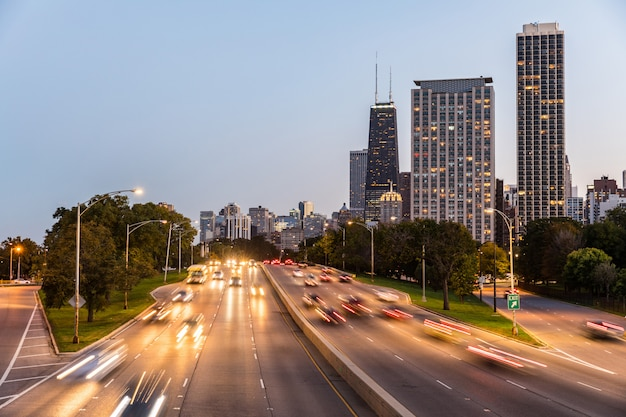 Chicago, traffic on highway with city skyscrapers Premium Photo