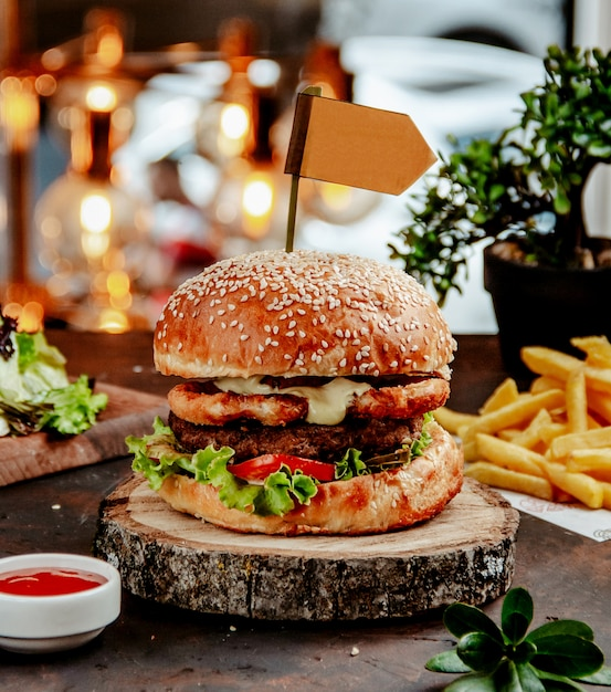 Chicken burger with french fries on the table Free Photo