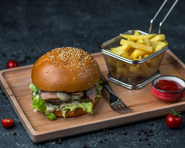 Chicken burger with keetchup and french fries. Free Photo