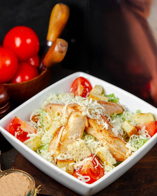 Chicken caesar salad in the plate Free Photo