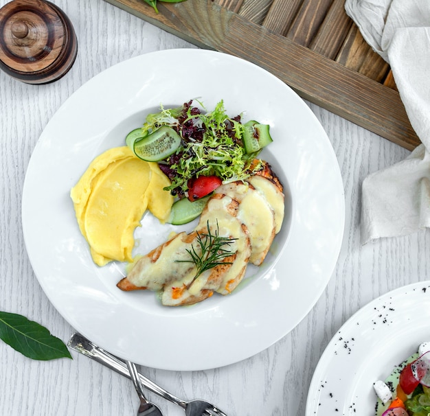 Chicken in cream sauce and mashed potatoes Free Photo