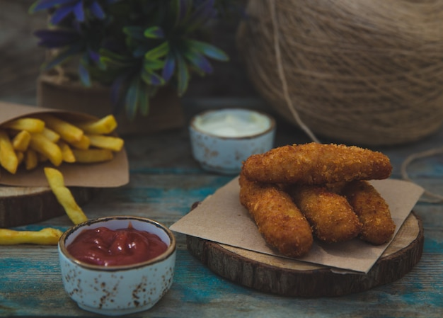 Chicken crispy sticks with barbecue sauce Free Photo
