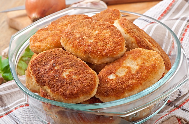 Chicken cutlets in a glass bowl Free Photo