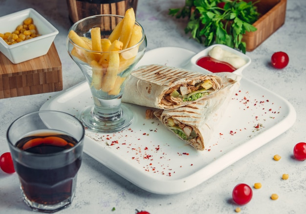 Chicken doner in lavash with french fries and cola Free Photo
