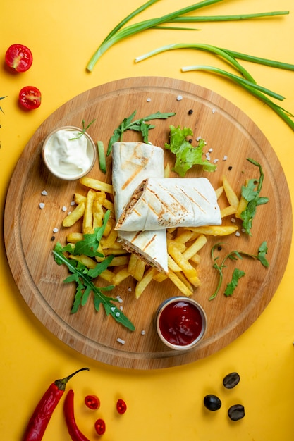 Chicken doner in lavash with fries Free Photo